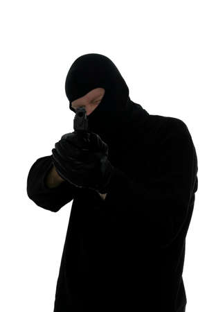 Terrorist all in black taking aim with a handgun. Stock Photo - 1621682