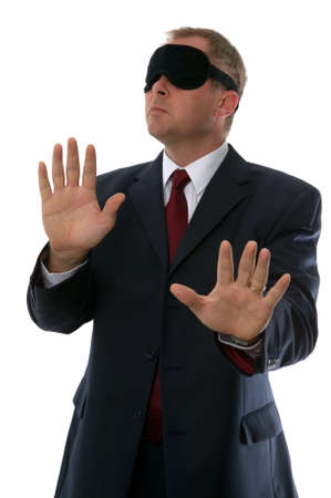 Businessman wearing a blindfold, Concepts: Confusion, Lost, Searching, Unsure plus many more. Stock Photo - 1695233