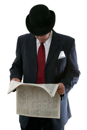 share prices: Businessman in bowler hat reading the stocks and share prices in a newspaper.