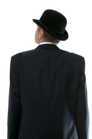 Businessman in a bowler hat looking up to the future. Rear view.