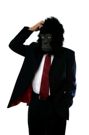 ape: Businessman in a gorilla mask, confused and scratching his head.