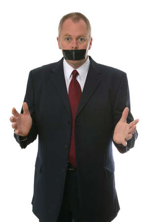 to restrain: Businessman gagged with tape. Concept - Freedom of speech, Something to say, Have your say.