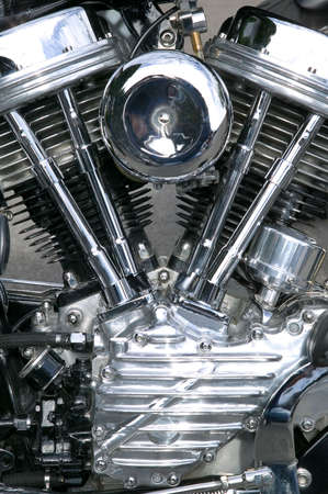 moto: Chrome engine on a custom motorcycle close up.