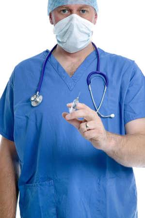 Surgeon holding a syringe, focus on the eyes. photo
