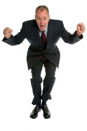Businessman jumping in the air, tiny bit of motion blur on trouser and jacket bottoms. photo