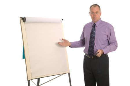 Businessman giving a presentation using a flip chart, blank for your own text. photo