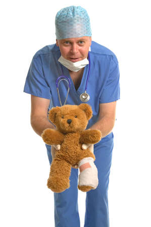 giving back: Pediatrician giving back a wounded teddy bear with a bandaged leg.