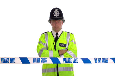 British Police officer standing behind some cordon tape. Focus is on the tape. Stock Photo - 1850815