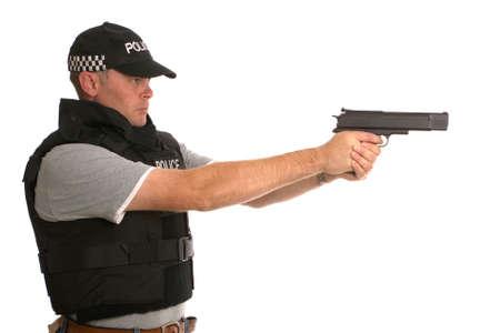 policier: Undercover agent de la police arm�s c�t� profil.