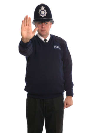 British Police Officer gesturing for you to STOP Stock Photo - 1850822