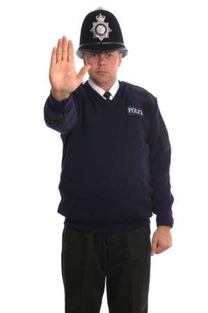 cease: Ufficiale di polizia britannico che gesturing per voi allARRESTO