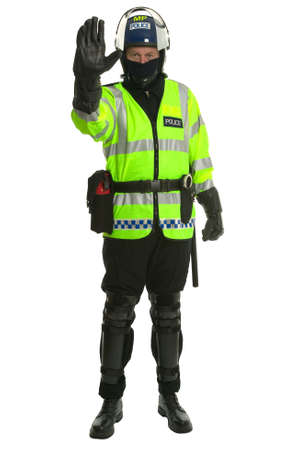 police body: Policeman in riot gear and hi-vis jacket gesturing to you to stop.