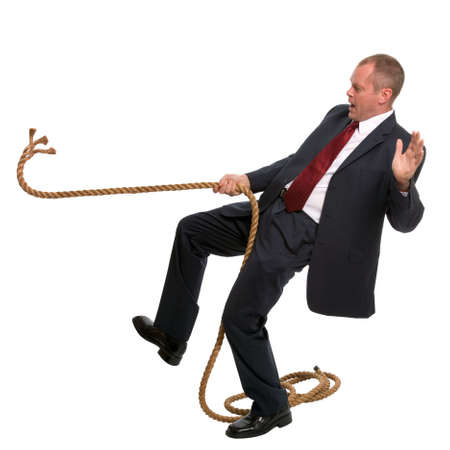 was: Businessman falling as the rope he was pulling breaks.