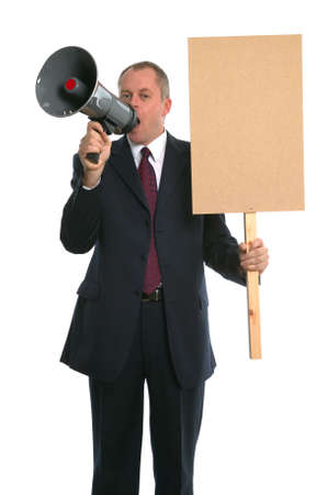 objection: Businessman with a loud haler and placard. Stock Photo