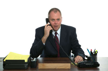 important phone call: Businessman sat at his desk making a phone call.