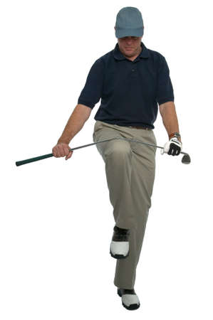 knee bend: Angry golfer breaking a club over his knee.