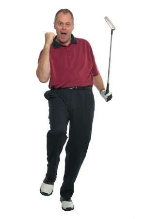 Golfer in a red shirt celebrating after sinking a great putt.