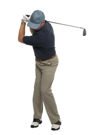 Front view of a golfer during his back swing with an iron. photo