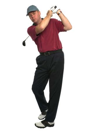 columpios: El tiro del los golfistas sigue a trav�s del oscilaci�n despu�s de que un tiro de madera. Foto de archivo