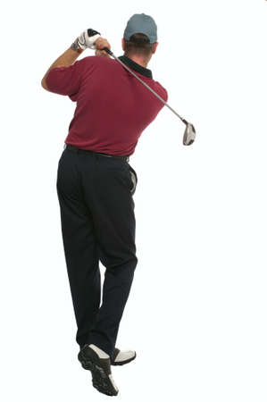 Rear view of a golfer during his back swing. Stock Photo