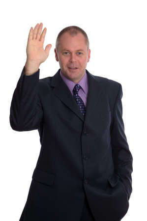 Businessman waving and saying Hi, isolated on white.