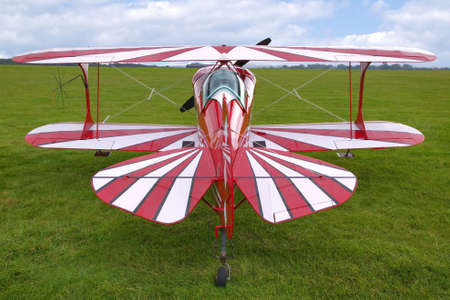 Rear view of a red biplane, now used for aerobatics. photo