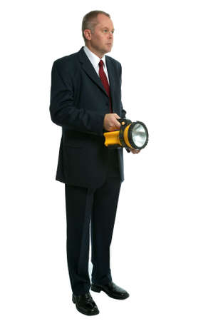 Businessman searching with a flashlight.