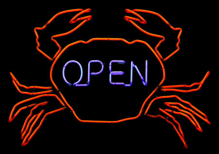 Neon sign of a Crab with the word Open. photo