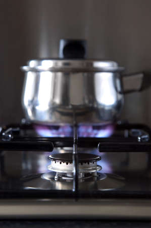 Close up of a gas hob with a pan on the back burner, shallow DOF. Stock Photo - 2154809