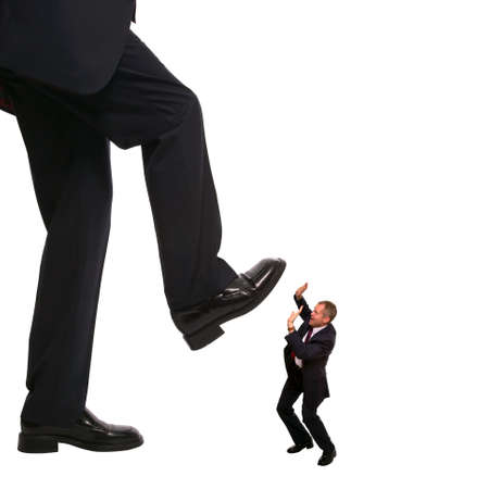 Concept image of an employee about to be stepped on by his manager. photo
