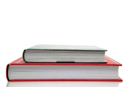 hardback: Two hardback books against a white background. Stock Photo