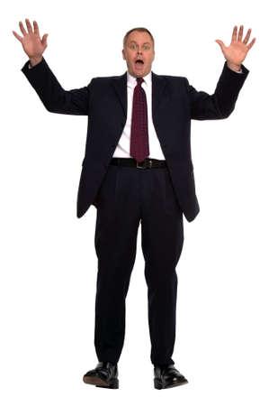 gasp: Businessman falling backwards against a white background Stock Photo
