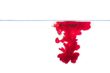 eau: Red ink forming and taking shape under water. Stock Photo
