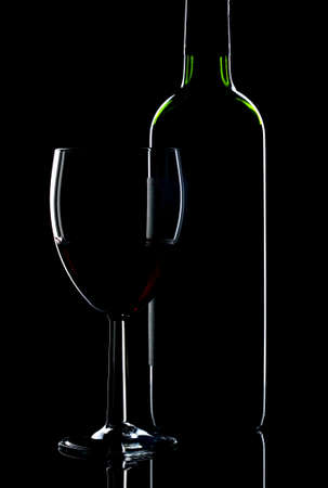 Low key shot of wine bottle and glass photo