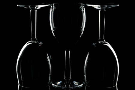 Low key shot of three wine glasses against black. photo