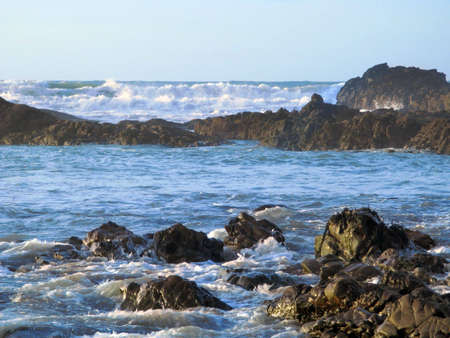 Waves breaking over a rocky shore Stock Photo - 2327454