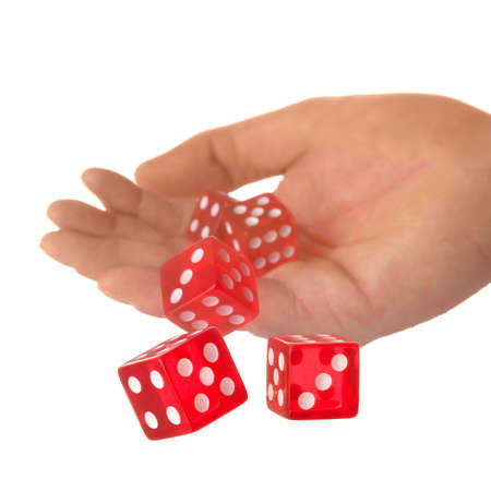 fortunate: Five red dice being thrown from a hand, shallow DOF. Stock Photo