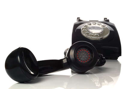 Retro black phone with focus on the handset in the foreground. photo