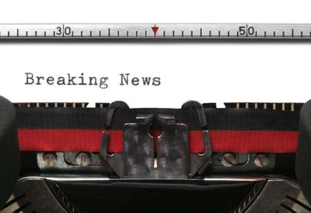 Breaking News typed on an old typewriter. Stock Photo