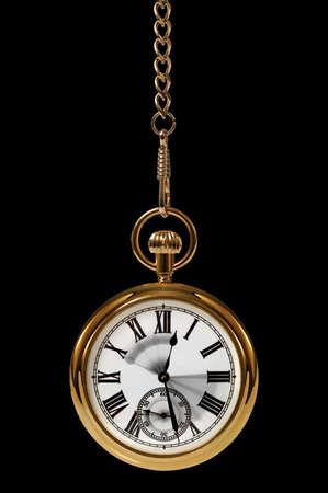 reloj de pendulo: Reloj de bolsillo de oro con el movimiento borroso en las manos para transmitir el paso del tiempo.