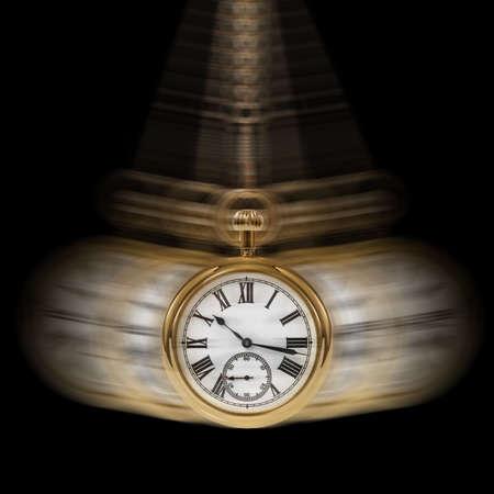 reloj de pendulo: Concepto de imagen que representa a tiempo y movimiento en un fondo negro.  Foto de archivo