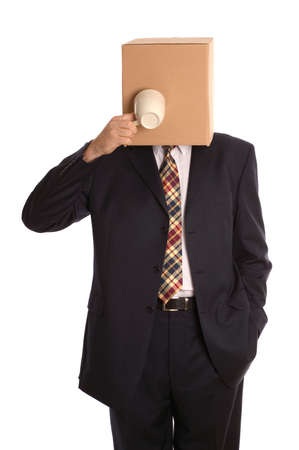 inconspicuous: An anonymous businessman trying to drink some coffee. Stock Photo