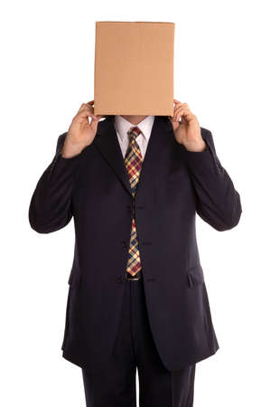 Businessman about to reveal himself from his hidden identity. photo