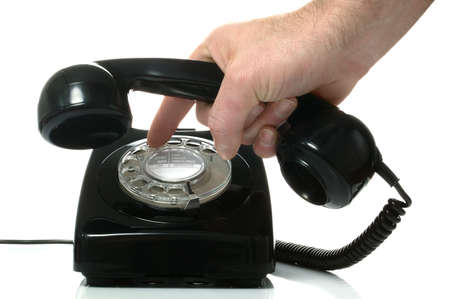 dialing: Dialing a number on an old black retro phone. Stock Photo