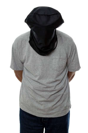 restrained: Man with a black hood over his head and his hands tied behind his back.