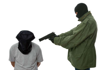 hostage: Kidnapper holding a gun to the head of a hooded man.