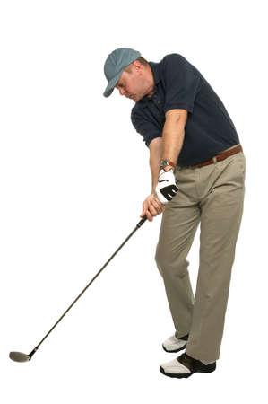 golfing: Deze golf afbeelding toont een perfect voorbeeld om je hoofd stil en je ogen op de bal bij het nemen van een schot. Stockfoto