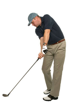 golfing: This golf image demonstrates a perfect example of keeping your head still and your eye on the ball when taking a shot.