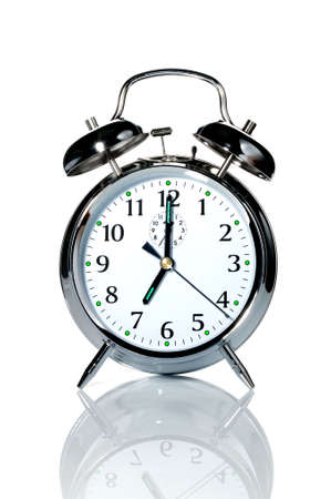 A chrome alarm clock with the hands at 7 o'clock. Stock Photo - 2520636