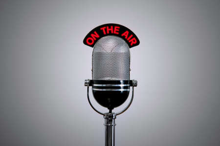 on air sign: Old retro microphone with illuminated On the Air sign.